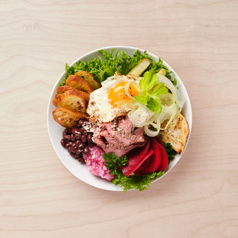 Bookmaker salad with flank steak, baked celeriacn, egg and dill pickles.